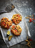 Noodle cakes with carrots and chillies