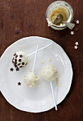 Cake pops with white chocolate icing and chocolate stars