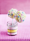 Cake pops with white chocolate glaze, mini stars and sugar decorations