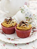 Salted caramel cupcakes with pecan nuts