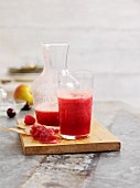 Pear and raspberry juice with cherries and cranberries