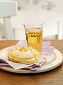 A whoopie pie with white chocolate and oranges