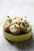 Smoked salmon rolls with green beans and sprouts