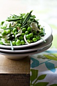 Pea salad with chives and onions