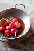 Cooked radishes and white turnips in a sauce