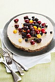 White chocolate cheesecake with cocoa splinters topped with fresh fruits