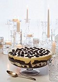 A Christmas chocolate trifle made with custard cream and cherries