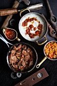 Beer-braised beef with pap (corn hash) and chakalaka relish (South Africa)