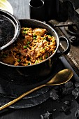 Paella with chicken, rabbit and wild boar