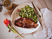 Angus Prime Center Cut Strip Steak with a Side Salad on a White Plate; Tulip