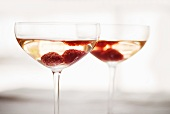 Two Glasses of Champagne with Raspberries