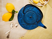 Blue Tea Pot with Lemons and Spoons; From Above
