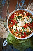 Shakshuka; Eggs Poached In Tomatoes with Capers