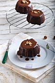 Individual chocolate puddings with walnuts