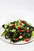 Seaweed salad with cucumber and wasabi-coated sesame seeds (Japan)