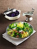 Chicory salad with watercress and prawns, with purple potatoes on the side