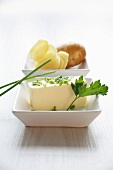 Potato slices and butter with chives and parsley