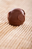 A home-made chocolate truffle coated in milk chocolate