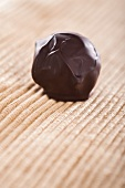 A home-made chocolate truffle coated in dark chocolate