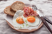 Fried eggs with bacon and bread