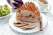 Studded roast pork with salad