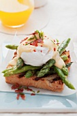 Toast with asparagus and Eggs Benedict