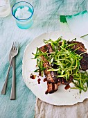 Marinated beef ribs with cucumber relish