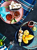 Grilled marshmallow skewers with mango