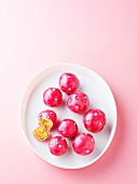 Marzipan and mascarpone sweets with bright pink coating