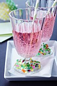 Drinking glasses decorated with confetti