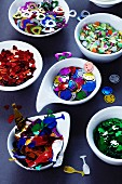 Dishes of various types of confetti for parties