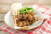 Pork and pepper kebabs with grilled tortilla