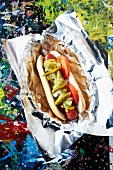 Smoked Hot Dog with Relish, Tomatoes, Mustard and Hot Pickled Peppers