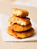 A stack of fried semolina cakes