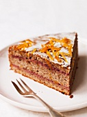 A slice of spice cake with oranges and sugar glaze
