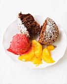 Chocolate muffin with raspberry ice cream and mandarin segments