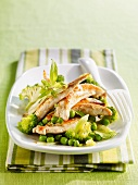 Strips of chicken fillet with peas and broccoli