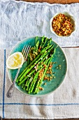 Green asparagus with breadcrumbs and chilli, garlic and lemon sauce