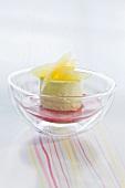 Lemon mousse in raspberry sauce