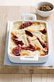 Potato and beetroot gratin in a casserole dish