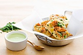 Corn pancakes with salmon and chives