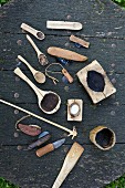Home-made, rustic cooking utensils on a wooden slab