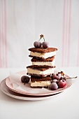 A stack of ice cream sandwiches with frozen cherries
