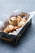 Coconut macaroons in a biscuit tin