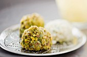Chocolate truffles with pistachios and white chocolate (close-up)
