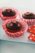 Chocolate muffins topped with sugar hearts