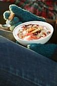 A woman eating Bircher muesli with winter fruits