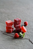 Cubes of raspberry and strawberry jelly