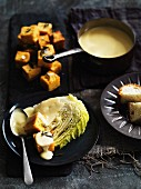 Fonduta valdostana (cheese fondue with polenta and Savoy cabbage, Italy)