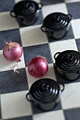 Red onions and small casserole dishes in the kitchen